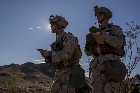 U.S. Marines 2nd Lt. John Donovan and Cpl. Tanner Reihm establish sectors of fire during a Marine Corps Combat Readiness Evaluation (MCCRE) at Marine Corps Air Ground Combat Center, Twentynine Palms, Calif., Nov. 28, 2017.