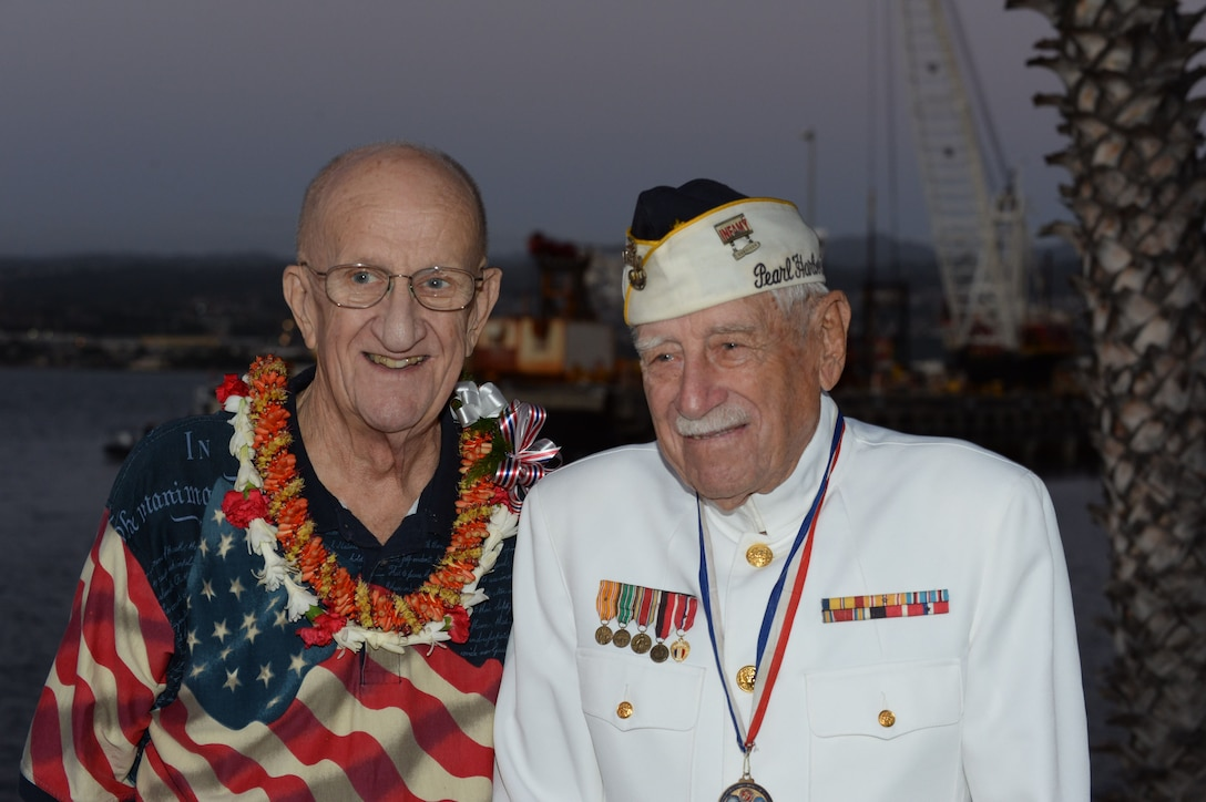 """Jim Taylor, the Pearl Harbor survivor liaison for Commander, Navy Region Hawaii, left, poses for a photo with Gil """"Wally"""" Meyer, a Pearl Harbor survivor, during a double interment ceremony at the USS Utah Memorial in Pearl Harbor, Hawaii."""