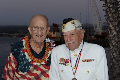 "Jim Taylor, the Pearl Harbor survivor liaison for Commander, Navy Region Hawaii, left, poses for a photo with Gil ""Wally"" Meyer, a Pearl Harbor survivor, during a double interment ceremony at the USS Utah Memorial in Pearl Harbor, Hawaii."