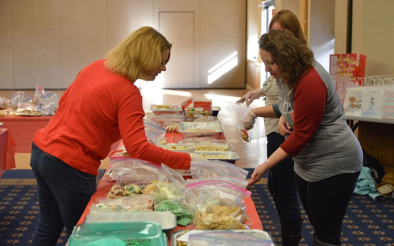Members of the Kirtland Spouses' Club organize cookie plates during the 2016 cookie drive. The KSC will run its annual drive Dec. 10-11 and hopes to best last year's donations, which reached more than 12,000 cookies donated from the base community.