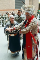 Erwin De Luna and his wife, Rose Mary, lead Brooke Army Medical Center staff in a traditional Native American dance Nov. 29 during the Native American Heritage Month ceremony in the Medical Mall.