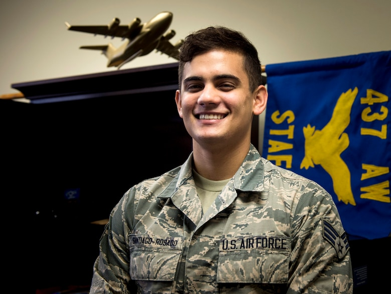 Senior Airman Ramon Santiago-Rosado works as an administrator within the command support staff of the 437th Airlift Wing Executive Support Services at Joint Base Charleston, S.C., Nov. 30, 2017.