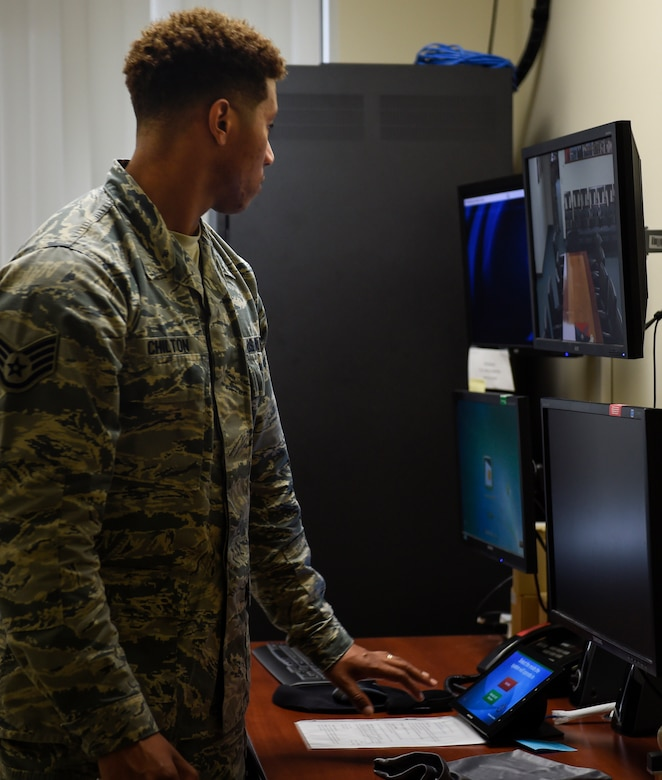 Staff Sgt. Damien Chilton, 628th Air Base Wing Executive Support Services noncommissioned officer in charge, sets up the audio and visual displays prior to a scheduled briefing at Joint Base Charleston, S.C., Dec, 4, 2017.