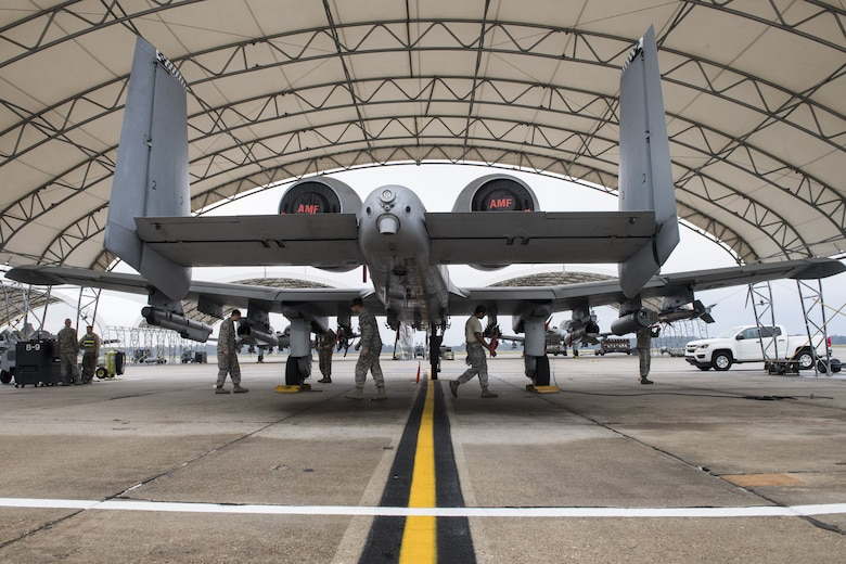 Moody's Wing Inspection Team examines an A-10C Thunderbolt II during an exercise, Dec. 5, 2017, at Moody Air Force Base, Ga. During Moody's Phase 1, Phase 2 exercise, leadership tested Airmen across maintenance units on their abilities to accurately and efficiently ready aircraft and cargo to deploy. The exercise tasked Airmen from various aircraft maintenance units (AMU) to generate 16 aircraft from Moody's fleet of A-10C Thunderbolt II's. (U.S. Air Force photo by Senior Airman Janiqua P. Robinson)