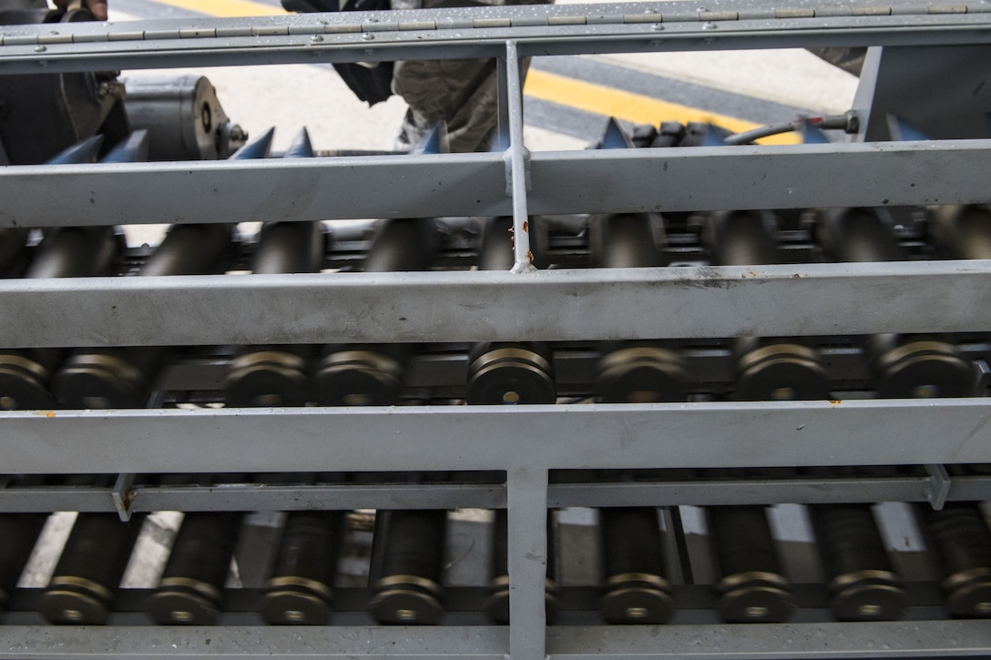 Thirty millimeter rounds travel on an Ammunition Loading Assembly into the GAU-8 Avenger autocannon of an A-10C Thunderbolt II during an exercise, Dec. 5, 2017, at Moody Air Force Base, Ga. During Moody's Phase 1, Phase 2 exercise, leadership tested Airmen across maintenance units on their abilities to accurately and efficiently ready aircraft and cargo to deploy. The exercise tasked Airmen from various aircraft maintenance units (AMU) to generate 16 aircraft from Moody's fleet of A-10C Thunderbolt II's. (U.S. Air Force photo by Senior Airman Janiqua P. Robinson)