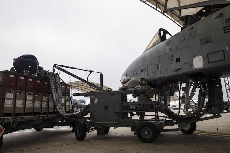 Airmen from the 23d Aircraft Maintenance Unit use an Ammunition Loading Assembly to reload 30 millimeter rounds into the GAU-8 Avenger autocannon of an A-10C Thunderbolt II during an exercise, Dec. 5, 2017, at Moody Air Force Base, Ga. During Moody's Phase 1, Phase 2 exercise, leadership tested Airmen across maintenance units on their abilities to accurately and efficiently ready aircraft and cargo to deploy. The exercise tasked Airmen from various aircraft maintenance units (AMU) to generate 16 aircraft from Moody's fleet of A-10C Thunderbolt II's. (U.S. Air Force photo by Senior Airman Janiqua P. Robinson)