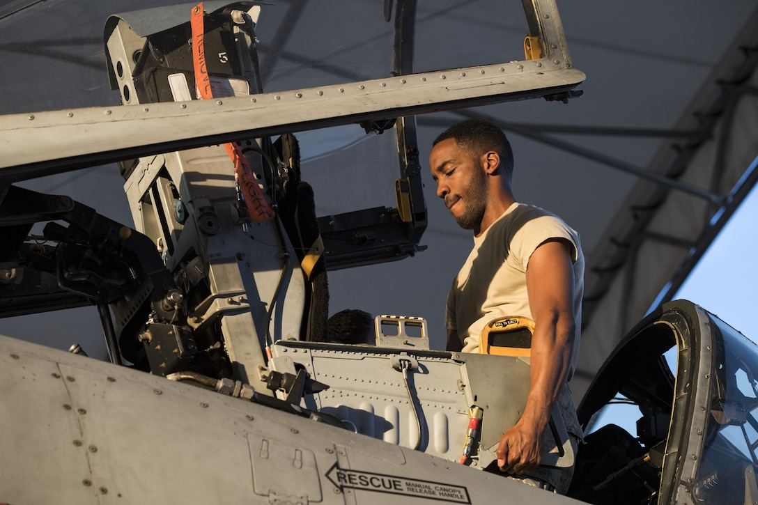 Airman 1st Class Andre Francis, 23d Aircraft Maintenance Squadron  egress apprentice, adjusts a seat in the cockpit of an A-10C Thunderbolt II during an exercise, Dec. 5, 2017, at Moody Air Force Base, Ga. During Moody's Phase 1, Phase 2 exercise, leadership tested Airmen across maintenance units on their abilities to accurately and efficiently ready aircraft and cargo to deploy. The exercise tasked Airmen from various aircraft maintenance units (AMU) to generate 16 aircraft from Moody's fleet of A-10C Thunderbolt II's. (U.S. Air Force photo by Senior Airman Janiqua P. Robinson)
