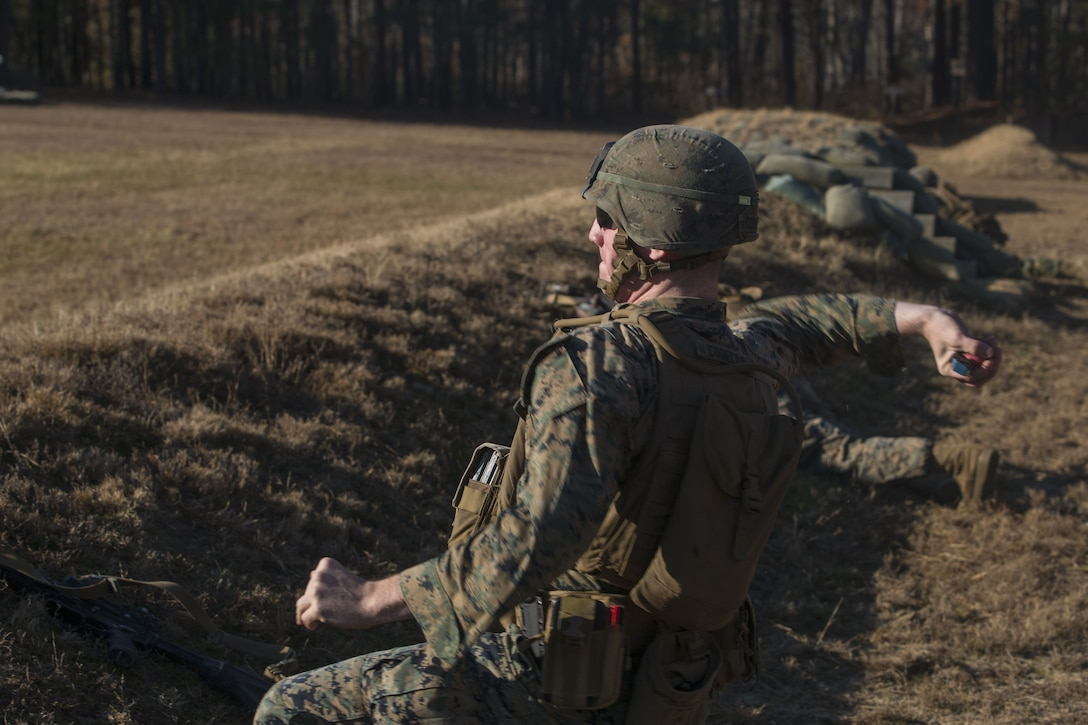 A Marine with 2nd Battalion, 8th Marine Regiment throws an M69 training grenade at a grenade range during a deployment for training exercise at Fort A.P. Hill, V.A., Dec. 1, 2017. The range consisted of the Marines reacting to enemy contact, buddy rushing, using M69 training grenades and M67 fragmentation grenades. The Marines are conducting the DFT to maintain proficiency at the squad, platoon, company, and battalion-level of warfighting in preparation for an upcoming deployment to Japan. (U.S. Marine Corps photo by Lance Cpl. Ashley McLaughlin)