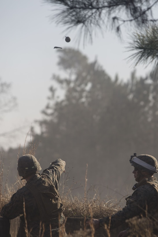 A Marine with 2nd Battalion, 8th Marine Regiment throws an M67 fragmentation grenade at a grenade range during a deployment for training exercise at Fort A.P. Hill, V.A., Dec. 1, 2017. The range consisted of the Marines reacting to enemy contact, buddy rushing, using M69 training grenades and M67 fragmentation grenades. The Marines are conducting the DFT to maintain proficiency at the squad, platoon, company, and battalion-level of warfighting in preparation for an upcoming deployment to Japan. (U.S. Marine Corps photo by Lance Cpl. Ashley McLaughlin)