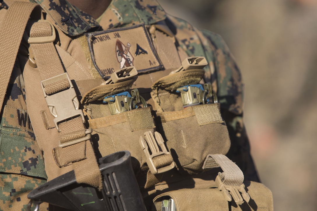 A Marine with 2nd Battalion, 8th Marine Regiment carries M69 training grenades loaded in his grenade pouches at a grenade range during a deployment for training exercise at Fort A.P. Hill, V.A., Dec. 1, 2017. The range consisted of the Marines reacting to enemy contact, buddy rushing, using M69 training grenades and M67 fragmentation grenades. The Marines are conducting the DFT to maintain proficiency at the squad, platoon, company, and battalion-level of warfighting in preparation for an upcoming deployment to Japan. (U.S. Marine Corps photo by Lance Cpl. Ashley McLaughlin)