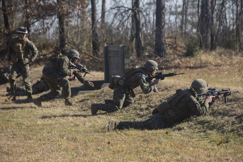 Marines with 2nd Battalion, 8th Marine Regiment complete buddy rushing and take cover at a grenade range during a deployment for training exercise at Fort A.P. Hill, V.A., Dec. 1, 2017. The range consisted of the Marines reacting to enemy contact, buddy rushing, using M69 training grenades and M67 fragmentation grenades. The Marines are conducting the DFT to maintain proficiency at the squad, platoon, company, and battalion-level of warfighting in preparation for an upcoming deployment to Japan. (U.S. Marine Corps photo by Lance Cpl. Ashley McLaughlin)
