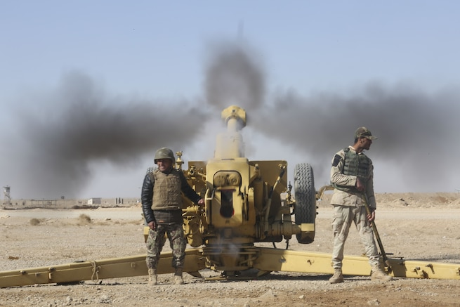 An Afghan National Army soldier with 1st Brigade, 215th Corps fires a 122mm howitzer D-30 prior during a live-fire training event at Camp Shorabak, Afghanistan, Dec. 5, 2017. The event concluded an eight-week artillery training course, which brought together more than 25 soldiers from the brigade to enhance their fire support capabilities. Led by U.S. Marine advisors with Task Force Southwest, the students will use their artillery skills to support infantry units during combat operations in Helmand province. (U.S. Marine Corps photo by Sgt. Lucas Hopkins)