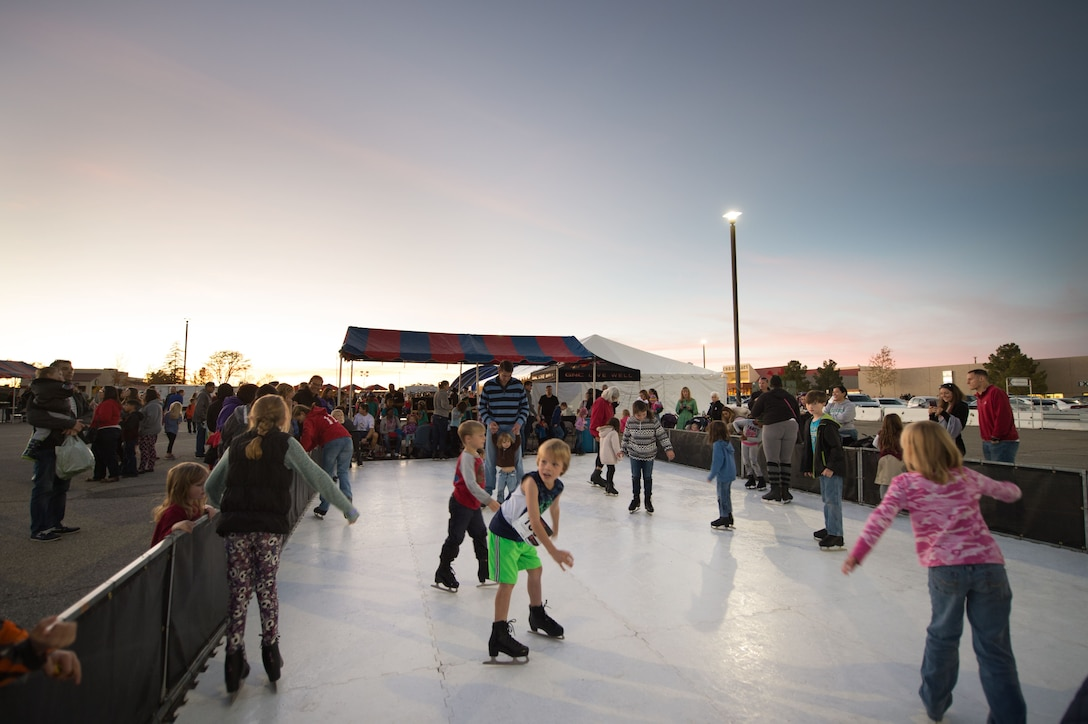Kids at Edwards enjoy a bit of twilight skating during Winterfest held Dec. 1.  Winterfest was organized by the 412th Force Support Squadron. (U.S. Air Force photo by Jennifer Correa)