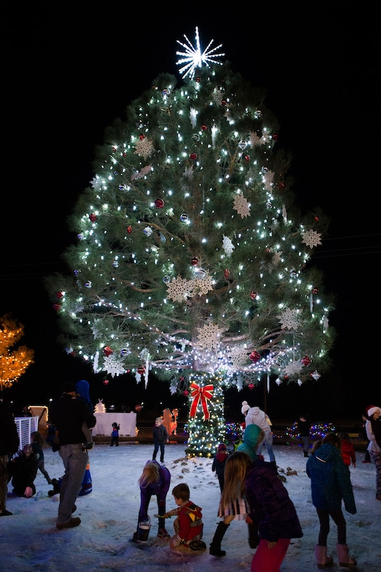 A holiday tree and 25 tons of man-made snow provide the centerpiece for Winterfest 2017, held at Edwards Air Force Base Dec. 1.  (U.S. Air Force photo by Jennifer Correa)