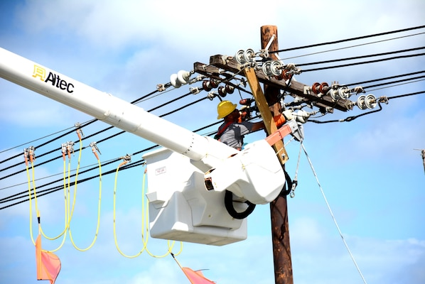 A USACE contractor works on repairing power lines near San Juan, Puerto Rico as part of the agency's work to help restore power on the island.