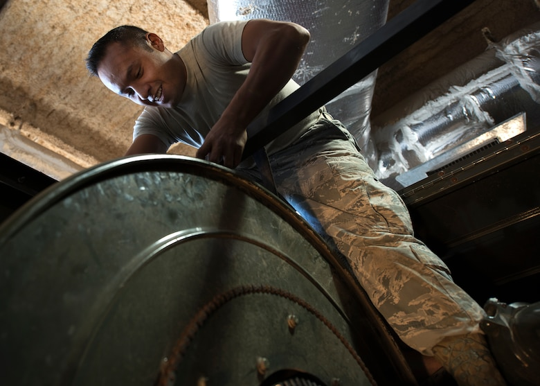 Tech. Sgt. Mario Garcia, 49th Logistics Readiness Squadron fire truck and refueling maintenance non-commissioned officer in charge, places a strap to support the fuel hose storage system on a refueling truck at Holloman Air Force Base, N.M., Dec. 4, 2017. The shop is constantly working to replace broken parts on a vehicle, diagnose vehicle problems and general vehicle upkeep in support of Holloman's mission. (U.S. Air Force photo by Staff Sgt. Timothy M. Young)