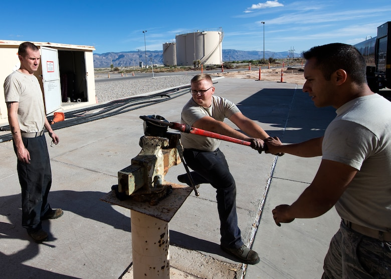Airmen from the 49th Logistics Readiness Squadron refueling maintenance shop use a vise and wrench to separate two vehicle parts that have been leaking fuel at Holloman Air Force Base, N.M., Dec. 4, 2017. The shop consists of three Airmen that are responsible for maintenance and upkeep of the base's refueling vehicles in support of Holloman's mission. (U.S. Air Force photo by Staff Sgt. Timothy M. Young)