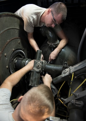 Senior Airman Tyler Lee Bordner and Senior Airman Johnathan Bailey, 49th Logistics Readiness Squadron mission generating vehicle and equipment maintenance journeymen, separate the gasket on a butterfly valve at Holloman Air Force Base, N.M., Dec. 4, 2017. The shop is constantly working, whether it's: replacing broken parts on a vehicle, diagnosing vehicle problems or general vehicle upkeep in support of Holloman's mission. (U.S. Air Force photo by Staff Sgt. Timothy M. Young)