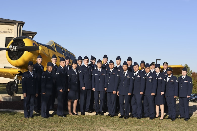 Airman Leadership School Class 18-A stands before the T-6 Texan static plane display on Goodfellow Air Force Base, Texas, Nov. 27, 2017. ALS is a six-week course designed to prepare senior airmen to assume supervisory duties by offering instruction in leadership, followership, written and oral communication skills, and the profession of arms.