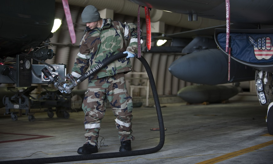 A U.S. Air Force Airman assigned to the 8th Fighter Wing, prepares to refuel an F-16 Fighting Falcon during exercise VIGILANT ACE 18 at Kunsan Air Base, Republic of Korea, Dec. 4, 2017.  The regularly scheduled flying exercise features more than 230 aircraft with U.S. and Republic of Korea Air Force personnel working alongside each other, comparable to participation from previous years' iterations. (U.S. Air Force photo by Staff Sgt. Victoria H. Taylor)