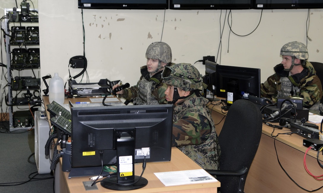 U.S. Air Force 8th Fighter Wing Security Forces Squadron Defenders and Republic of Korea Special Operations Forces 35th Battalion, 7th Brigade, coordinate base security efforts from a command post at Kunsan Air Base, Republic of Korea, Dec. 6, 2017. The U.S. and ROK service members orchestrate mobile foot patrols, defensive fighting positions and integrated defense tactics with combined forces defending critical assets and personnel on Kunsan. The combination of both forces provides not only internal but external base defense for Kunsan. (U.S. Air Force photo by Senior Airman Colby L. Hardin)