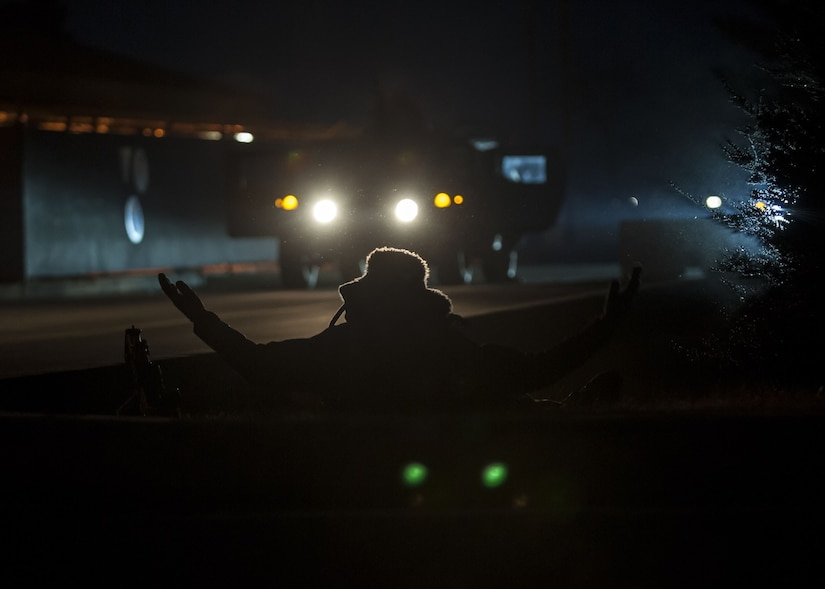 A U.S. Air Force Airman assigned to the 8th Security Forces Squadron acts as a member of an opposing force to simulate a base attack during exercise VIGILANT ACE 18 at Kunsan Air Base, Republic of Korea, Dec. 6, 2017. The week-long exercise tested the squadron's ability to defend the base in a wartime scenario. Various simulated attacks on the installation enhanced the skills and training of Wolf Pack Airmen and their ability to respond to threats. (U.S. Air Force photo by Staff Sgt. Victoria H. Taylor)