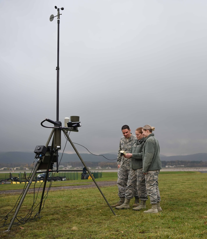 U.S. Airmen assigned to the 86th Operations Support Squadron fine tune settings on a Tactical Meteorological eQuipment – 53, on Ramstein Air Base, Germany, Nov. 8, 2017. The TMQ-53 is the deployable version of the Field Meteorological eQuipment – 19. It is less precise than the FMQ-19 but has the same function.