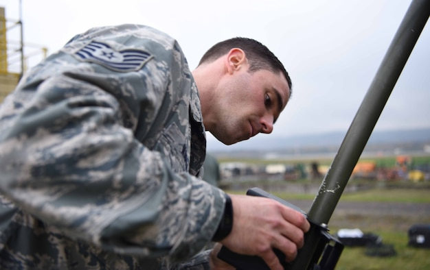 U.S. Air Force Tech. Sgt. Alexander Marsh, 86th Operations Support Squadron noncommissioned officer in charge of air field services element, constructs the Tactical Meteorological eQuipment – 53 during a team training exercise, on Ramstein Air Base, Germany, Nov. 8, 2017. The weather team performs these exercises routinely to ensure they are prepared to make manual observations.