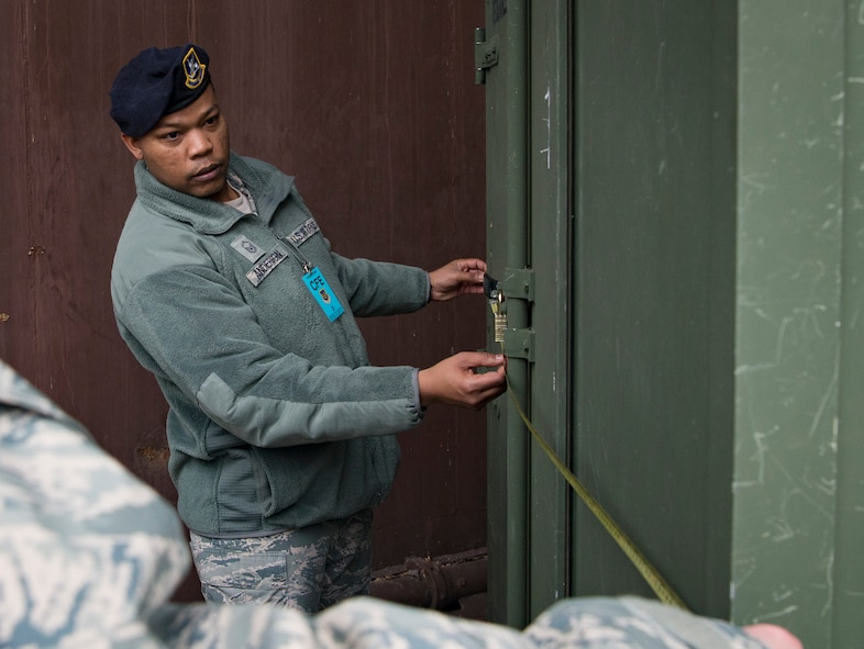 U.S. Air Force Master Sgt. Mario Anderson, 569th Security Forces noncommissioned officer in charge of installation security section, measures the width of a container during a Conventional Arms Forces in Europe Inspection Exercise on Ramstein Air Base, Germany, Dec. 6, 2017. According to the Conventional Arms Forces Europe treaty, inspectors have the right to see inside containers with outer dimensions of at least two meters on all sides, because anything smaller cannot store treaty-specific equipment, such as tanks and aircraft. (U.S. Air Force photo by Senior Airman Elizabeth Baker)