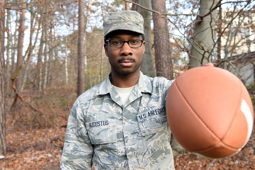 U.S. Air Force Airman 1st Class Jaron Augustus, 86th Communications Squadron, systems technician, holds a football while posing for a photo on Ramstein Air Base Dec. 7, 2017. Augustus was selected to represent his unit in the Salute to Service event held in New Orleans, Lousiana, Nov. 6, 2017.