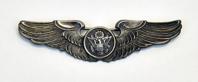 "Plans call for this artifact to be displayed near the B-17F Memphis Belle™ as part of the new strategic bombardment exhibit in the WWII Gallery, which opens to the public on May 17, 2018. Memphis Belle gunner SSgt William ""Bill"" Winchell's enlisted aircrew member badge.  Winchell was credited with downing an Fw 190 fighter."