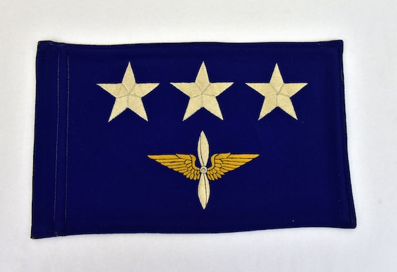 "Plans call for this artifact to be displayed near the B-17F Memphis Belle™ as part of the new strategic bombardment exhibit in the WWII Gallery, which opens to the public on May 17, 2018. Three-star general's flag flown on Lt Gen James ""Jimmy"" Doolittle's staff car while he commanded the Eighth Air Force."