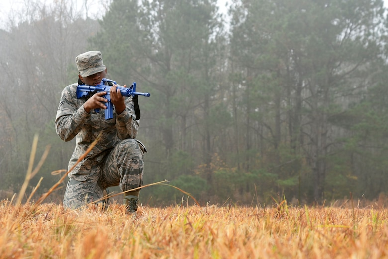 U.S. Air Force Airman 1st Class Taryph Moses, 20th Force Support Squadron food service journeyman, holds a training rifle while participating in a team movement training at Poinsett Electronic Combat Range near Wedgefield, S.C., Dec. 5, 2017.