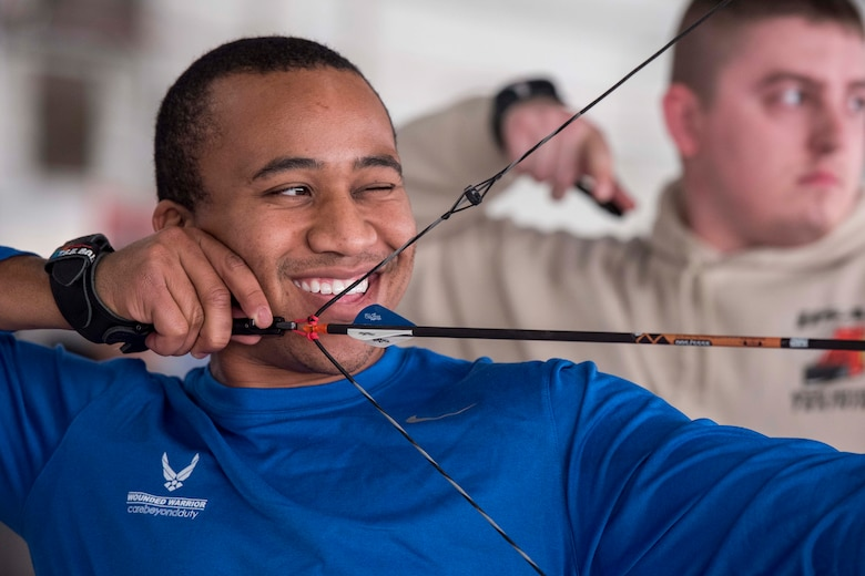 Derek Silas, Warrior CARE participant, shoots an arrow with a compound bow during an archery training session at Joint Base Andrews, Md., Nov. 13, 2017. The Air Force Wounded Warrior CARE Event featured multiple activities meant to educate injured service members about caregiver support, adaptive and rehabilitative sports, recovering airman mentorship, and employment and career readiness. (U.S. Air Force photo by Airman 1st Class Valentina Lopez)