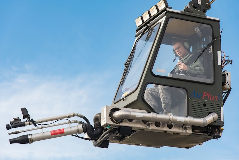 Brig. Gen. Steven Bleymaier, director of logistics, engineering and force protection, Headquarters Air Mobility Command, Scott Air Force Base, Ill., steers a GL2875 High Reach Deicer during a test ride Nov. 30, 2017, at Dover AFB, Del. (U.S. Air Force photo by Roland Balik)