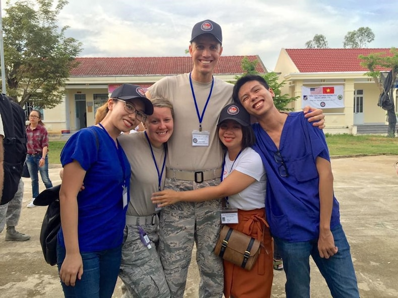 Maj. (Dr.) Cody Butler, 78th Medical Group Clinical Medicine Flight commander, poses with other members of his engagement team in Tam Ky, Quang Nam Province, Vietnam. Butler, a physical therapist, was in Vietnam as part of a team seeing patients and building relationships with local physicians during the humanitarian assistance engagement Operation Pacific Angel Vietnam 2017. (U.S. Air Force photo)