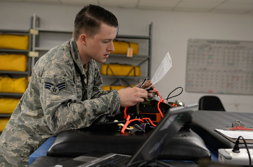Senior Airman Hayden Harrison, 48th Flying Training Wing Aircrew Flight Equipment technician, reads a T-6A Texan II survival equipment checklist Dec. 5, 2017, on Columbus Air Force Base, Mississippi. The T-6 and T-38C Talon have survival kits inside of the cockpit with each pilot and are an essential portion of the AFE mission. (U.S. Air Force photo by Airman 1st Class Keith Holcomb)