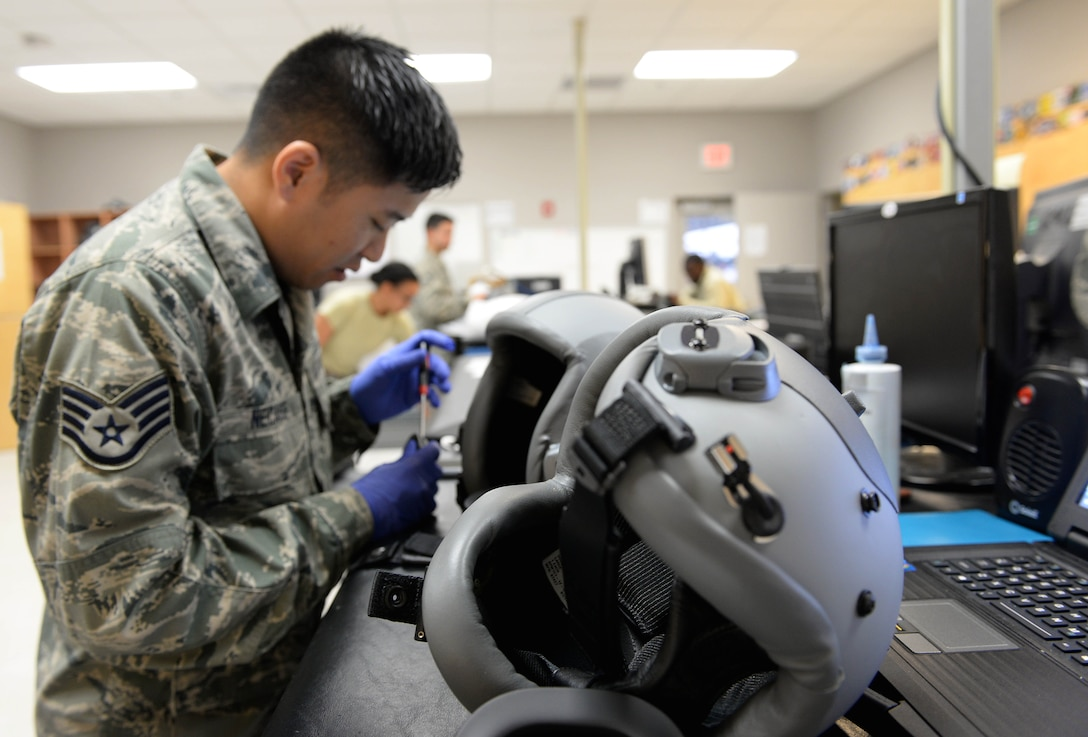 Staff Sgt. Jeremiah Necaise, 41st and 37th Flying Training Squadron Aircrew Flight Equipment technician, replaces parts on multiple helmets Dec. 5, 2017, on Columbus Air Force Base, Mississippi. Every helmet is made to fit every student individually, and the 41st and 37th FTS AFE Airmen take care of over 400 helmets. (U.S. Air Force photo by Airman 1st Class Keith Holcomb)