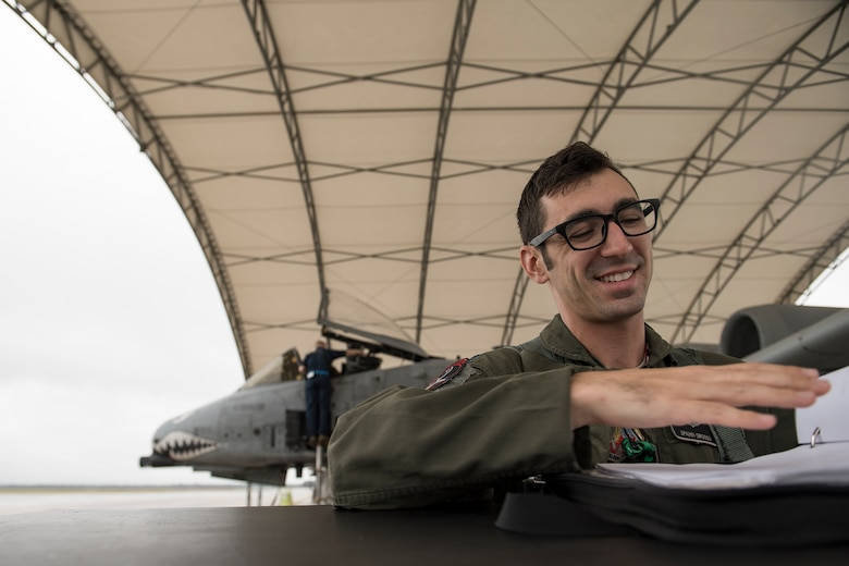 Capt. Maurice Grosso, 75th Fighter Squadron A-10C Thunderbolt II pilot, looks over paperwork prior to a sortie, Dec. 6, 2017, at Moody Air Force Base, Ga. Moody's week-long, Phase 1, Phase 2 exercise is designed to demonstrate the 23d Wing's ability to meet combatant commander objectives and tested the pilots' and maintainers' ability to launch around-the-clock sorties at an accelerated rate during a sortie surge. (U.S. Air Force photo by Staff Sgt. Ryan Callaghan)