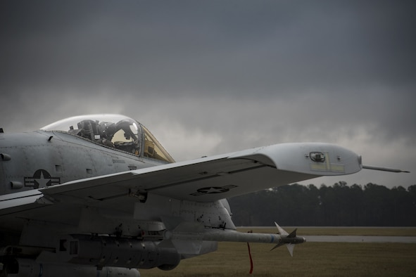 A pilot from the 75th Fighter Squadron taxis an A-10C Thunderbolt II towards the runway, Dec. 6, 2017, at Moody Air Force Base, Ga. Moody's week-long, Phase 1, Phase 2 exercise is designed to demonstrate the 23d Wing's ability to meet combatant commander objectives and tested the pilots' and maintainers' ability to launch around-the-clock sorties at an accelerated rate during a sortie surge. (U.S. Air Force photo by Staff Sgt. Ryan Callaghan)