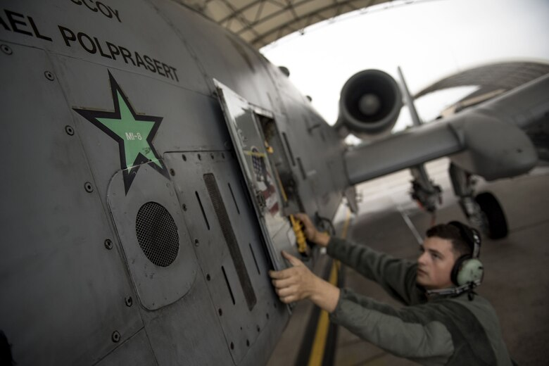 Airman 1st Class Kaya Schmidt, 74th Aircraft Maintenance Unit crew chief, secures an aircraft panel on the side of an A-10C Thunderbolt II, Dec. 6, 2017, at Moody Air Force Base, Ga. Moody's week-long, Phase 1, Phase 2 exercise is designed to demonstrate the 23d Wing's ability to meet combatant commander objectives and tested the pilots' and maintainers' ability to launch around-the-clock sorties at an accelerated rate during a sortie surge. (U.S. Air Force photo by Staff Sgt. Ryan Callaghan)