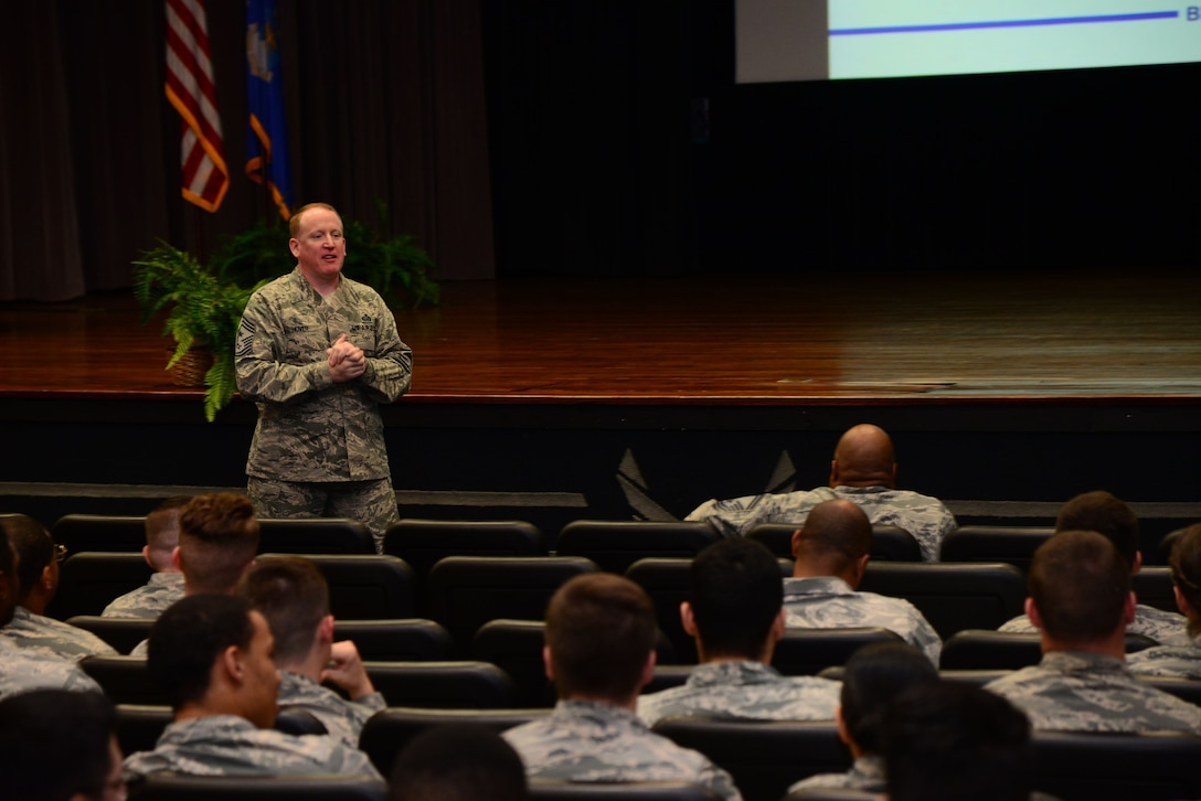Chief Master Sgt. Johnathan Hover, 14th Flying Training Wing Command Chief, speaks with enlisted Airmen at an enlisted all call Dec. 1, 2017, at the Kaye Auditorium on Columbus Air Force Base, Mississippi. During his all call Hover discussed future events, expectations of Airmen and welcomed feedback about items of interest such as the Wing Commander Shadow Program, promotion ceremonies, wing mentorship programs and more. (U.S. Air Force photo by Airman 1st Class Beaux Hebert)