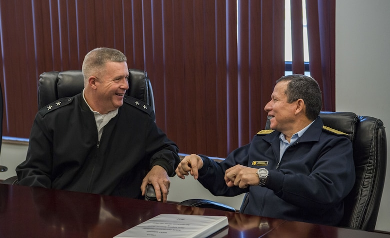 U.S. Army Maj. Gen. James A. Hoyer, the Adjutant General of the West Virginia National Guard, shares a laugh with Peruvian Air Force Maj. Gen. Gregorio C. Mendiola, Assistant Defense and Air Attaché for the Embassy of Peru, while discussing ways in which the West Virginia National Guard and the country of Peru's military can extend their partnership Nov. 21, 2017 at McLaughlin Air National Guard Base, Charleston, W.Va. The State Partnership Program (SPP) is designed to build and improve relations around the globe through 73 security partnerships with different countries, including Peru as West Virginia's partner. (U.S. Air National Guard Photo by Airman Caleb Vance)