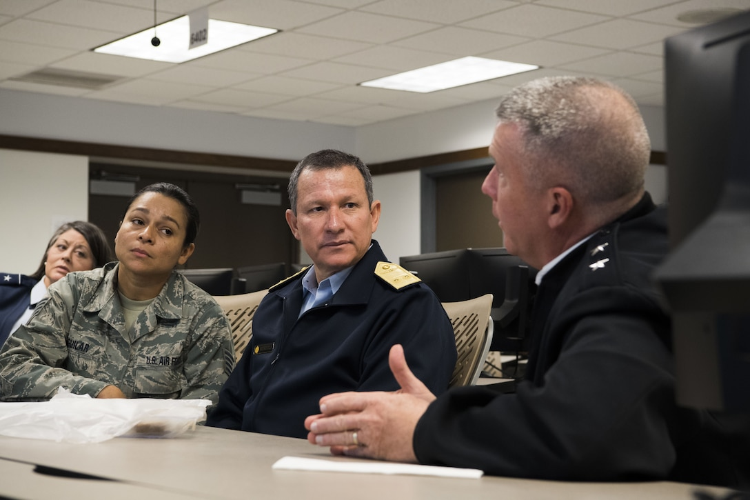 U.S. Army Maj. Gen. James A. Hoyer, the Adjutant General of West Virginia National Guard, discusses domestic response operations and capabilities with Peruvian Air Force Maj. Gen. Gregorio C. Mendiola, Assistant Defense and Air Attaché for the Embassy of Peru, at the WVNG Joint Force Headquarters Joint Operations Center (JOC). Mendiola visited the 130th Airlift Wing and JFHQ to see first hand the domestic response capabilities of Army and Air National Guard assets including the C-130H and aeromedical evacuation mission. (U.S. Air National Guard Photo by Capt. Holli Nelson)