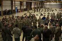 Members of the U.S. Air Force, U.S. Army, German, Italian, Dutch, British, and Estonian militaries, receive a mission brief before gearing up for Operation Toy Drop 2017 on Ramstein Air Base, Germany, Dec. 6, 2017. The paratroopers participated in Operation Toy Drop 2017 to maintain their military free fall and jump master proficiencies, and to improve NATO interoperability. (U.S. Air Force photo by Senior Airman Devin M. Rumbaugh)