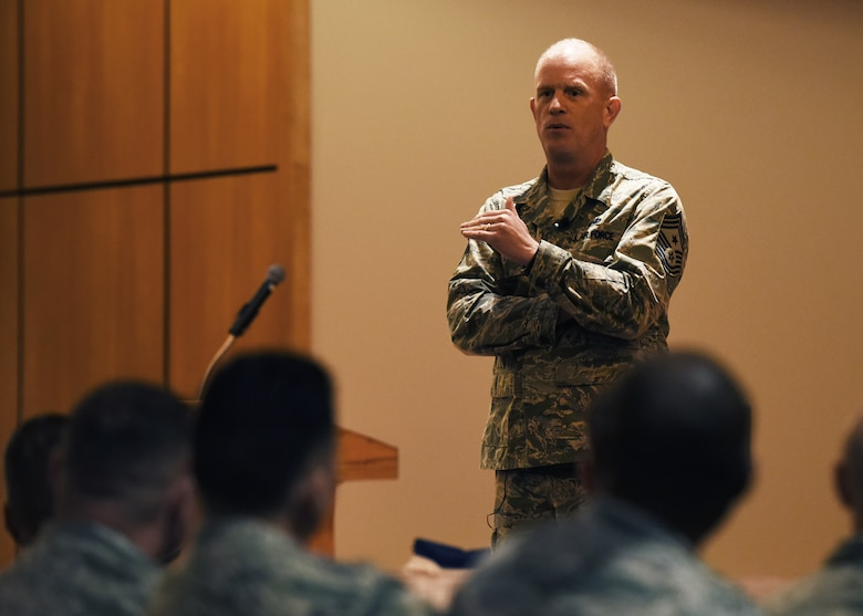 U.S. Air Force Chief Master Sgt. Frank H. Batten III, Air Combat Command command chief, speaks with Tyndall Airmen during an all-call Dec. 7, 2017 at the Horizons Community Center.