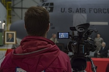 "A local news reporter records a speech given by U.S. Army Maj. Gen. James Hoyer, the Adjutant General of the West Virginia National Guard, at a C-130H plane naming ceremony Dec. 7, 2017 at McLaughlin Air National Guard Base, Charleston, W.Va. The aircraft was given the name ""The General Mac"" to honor Brig. Gen. (ret) James K. McLaughlin, who founded the West Virginia Air National Guard and was a pilot in World War II with the famous Eight Air Force. (U.S. Air National Guard photo by Airman Caleb Vance)"
