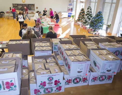 Hundreds of boxes of donated, homemade cookies are ready for distribution while volunteers pack more.The cookie drive was sponsored by the Wright-Patterson Enlisted Spouses Club, Wright-Patterson Officers Spouses Club, First Command, First Sergeants Council, United Service Organization of Central and Southern Ohio and the City of Fairborn. (U.S. Air Force photo/R.J. Oriez)