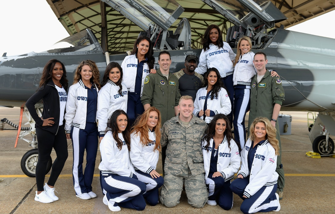 The Dallas Cowboys Cheerleaders stand with pilots next to a T-38C Talon Dec. 4, 2017, on the flight line at Columbus Air Force Base, Mississippi. The cheerleaders were able to sit inside the aircraft and ask questions to learn about the airframe and how it flies. (U.S. Air Force photo by Airman 1st Class Keith Holcomb)