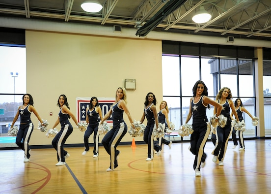 Members of the Dallas Cowboys Cheerleaders perform a routine for people at the Youth Center Dec. 4, 2017, on Columbus Air Force Base, Mississippi. Following their routine, the cheerleaders performed a Cheer to Fitness Clinic for children who attended. (U.S. Air Force photo by Staff Sgt. Christopher Gross)